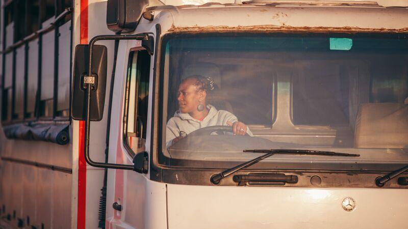 Becky driving a truck