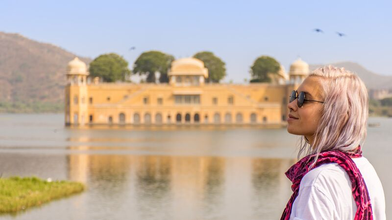 A young woman looking at a palace in India