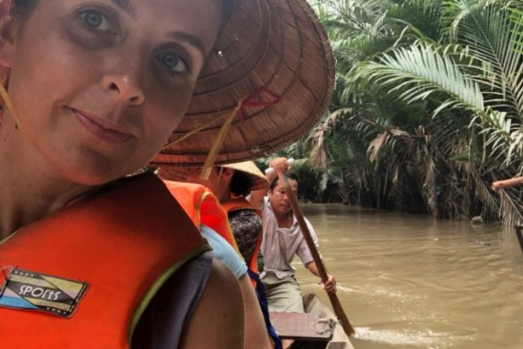 A woman in a lifejacket on the Mekong