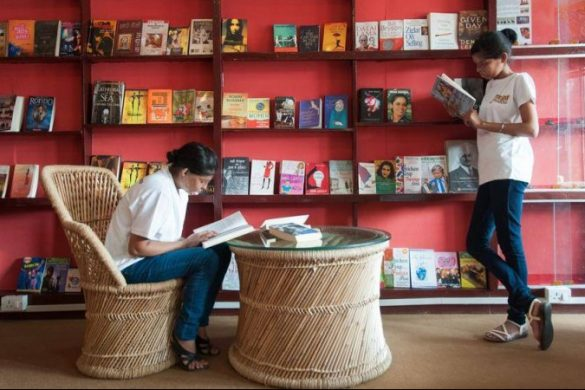 Two women reading in a bookshop in India