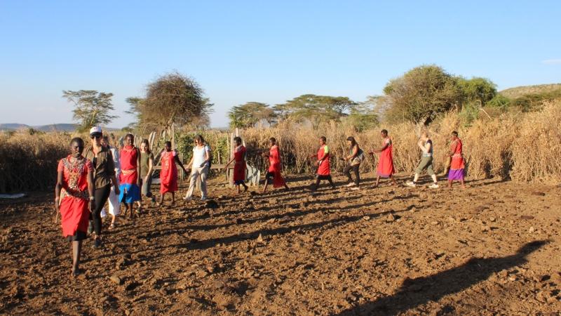 a group of women dancing in a circle on a Kenya safari