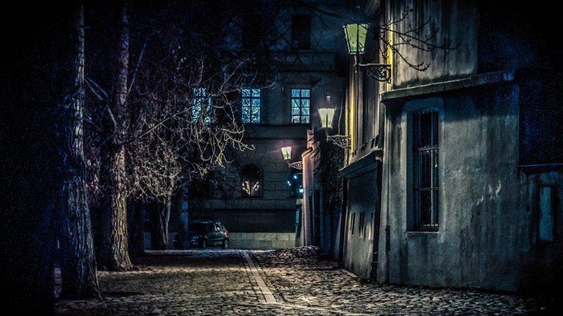 A dark street in Prague at night