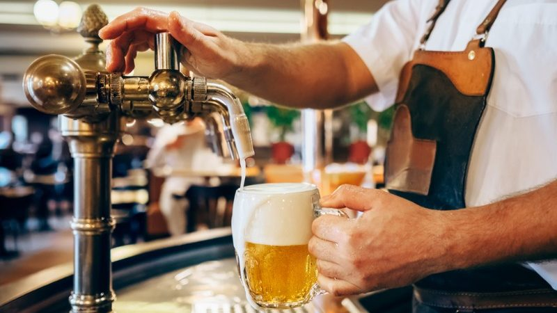 A man pouring a beer in the Czech Republic