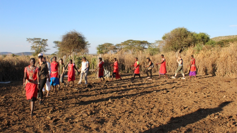 maasai people dancing with women