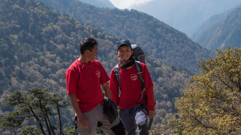 Two Intrepid Guide smiling in Nepal wearing red t-shirts