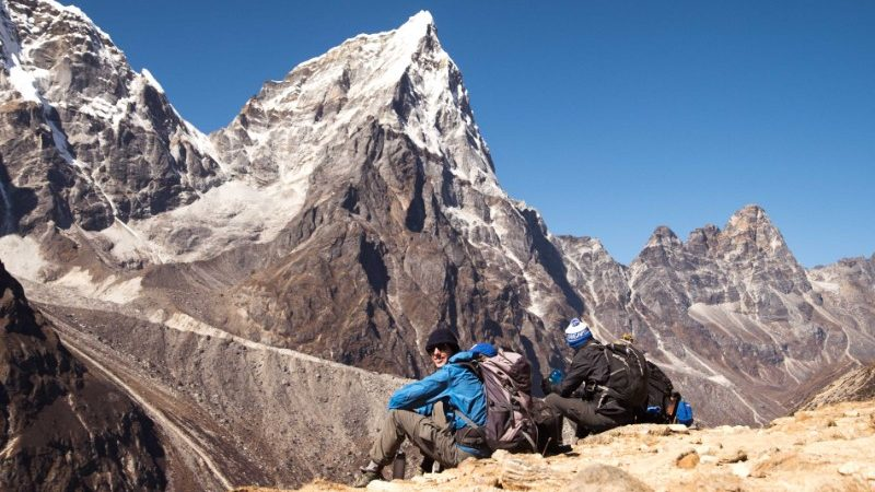 Two people under the peaks of Everest