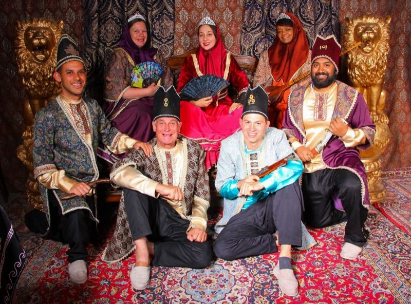 A group of travelers wearing traditional Persian outfits