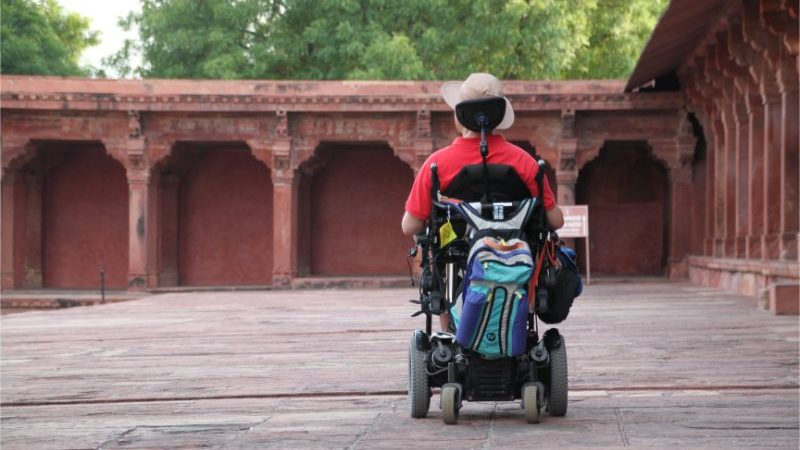 A man in wheelchair at a fort in India.