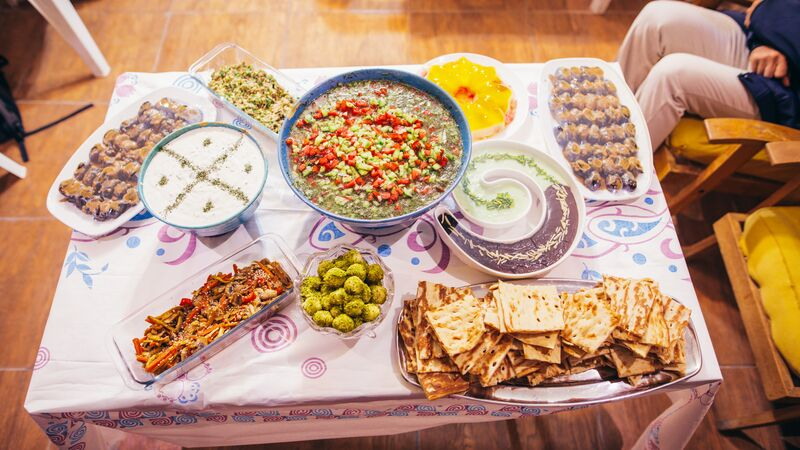 A table laden with Iranian food