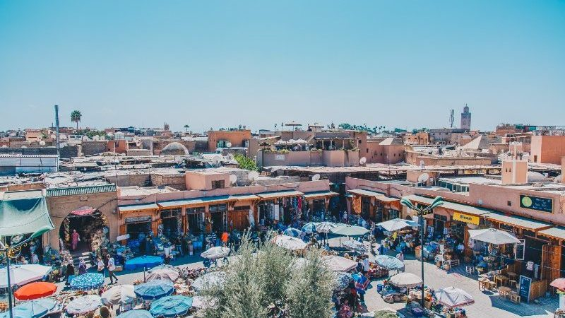 A clusters of umbrellas and market stills in Marrakech.