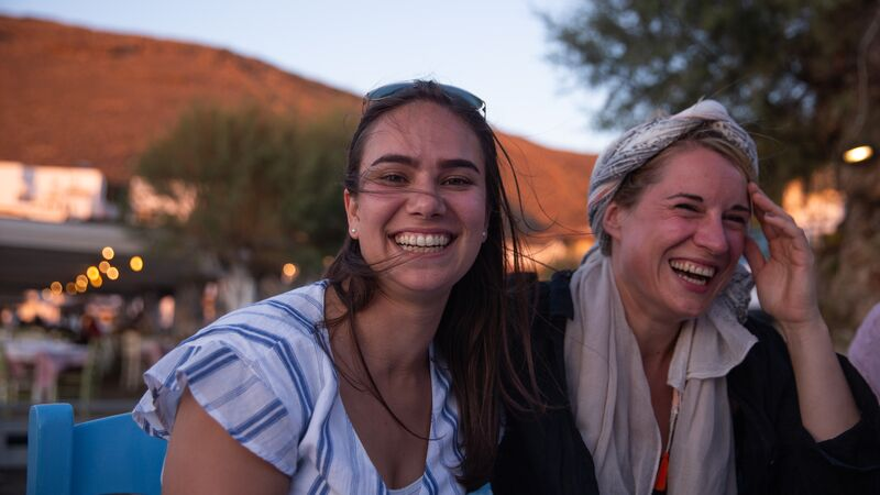 Two smiling travellers in Greece.