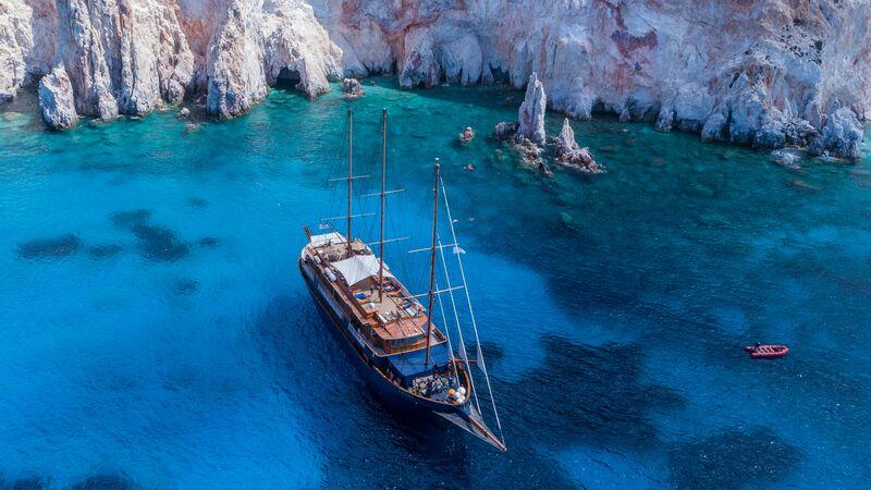 A boat in a beautiful cove in Greece