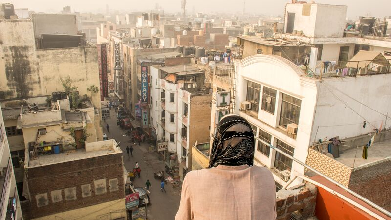 Woman standing on a roof in Delhi