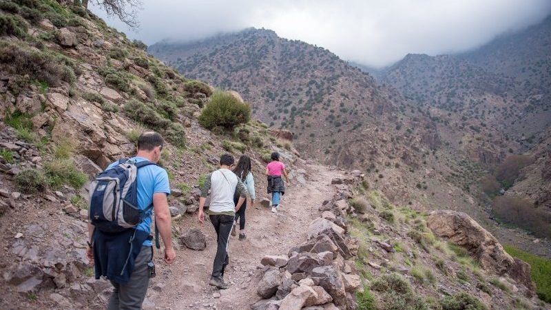 People hiking up a trail in the Altas mountains,