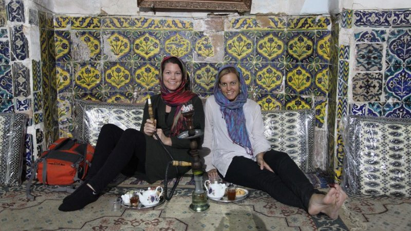Two women smoking a shisha in Iran