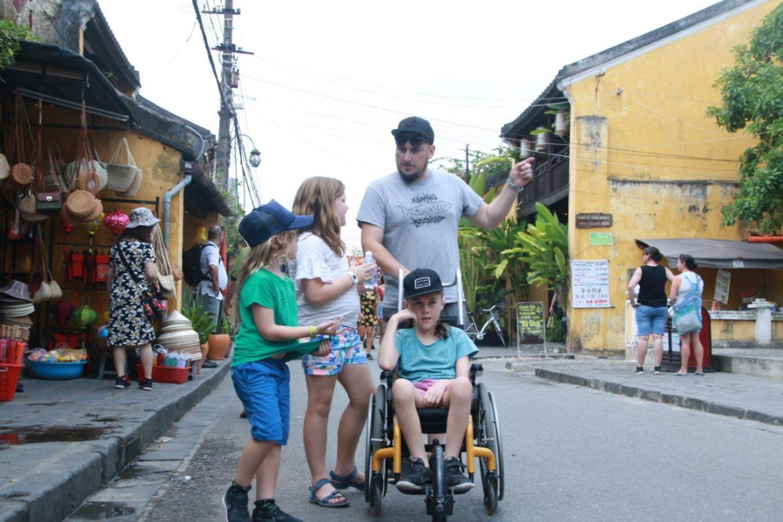 Three kids with their Dad in Vietnam