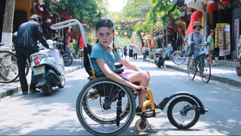 A young boy in his wheelchair