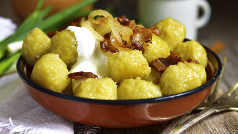 Potato dumplings topped with sour cream in Belarus