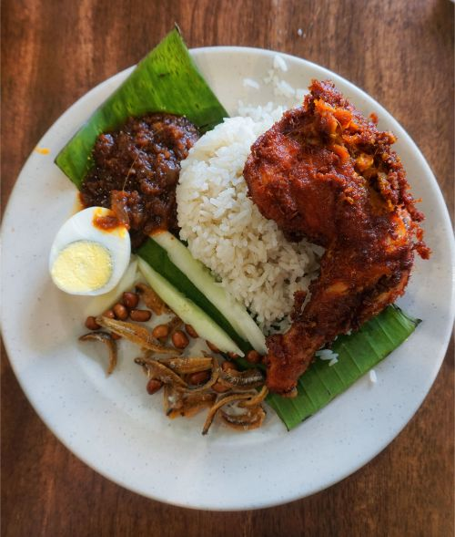 Plate filled with rice, curry and egg in Malaysia