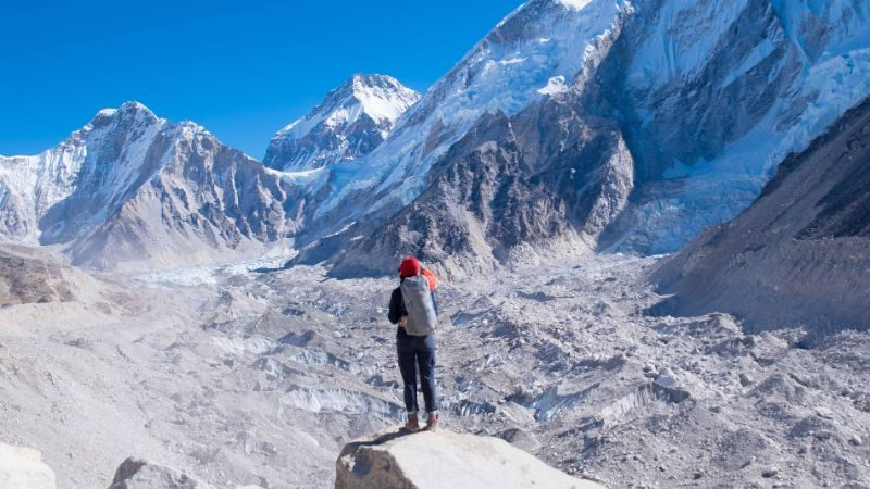 Person standing in the Himalayas overlooking the view