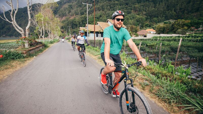 Cycling past villages in Bali.