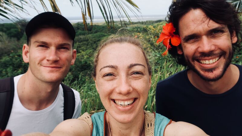 Three smiling travellers in Fiji