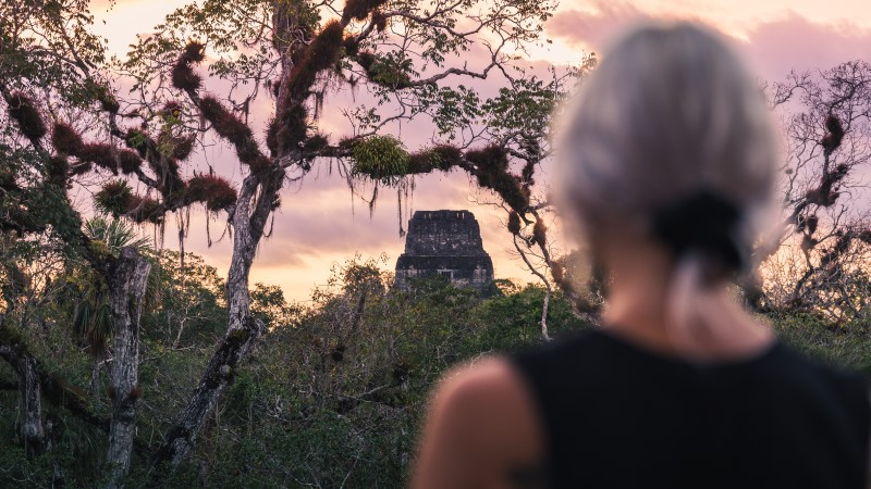 Admiring the sunset over Tikal in Guatemala