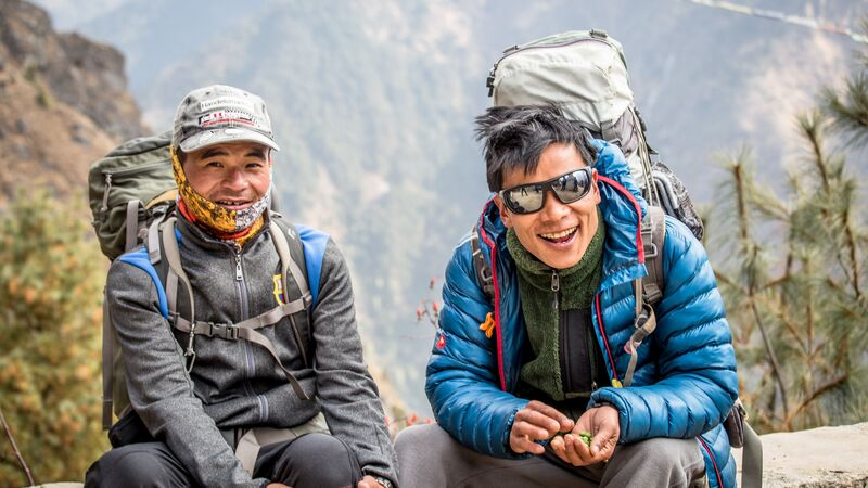 Two smiling porters in Nepal
