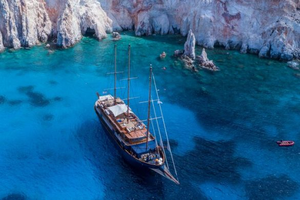 aerial shot of a small ship moored in a Greek bay.