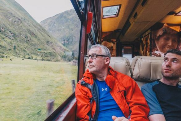 A man looks out the window on a train to Machu Picchu