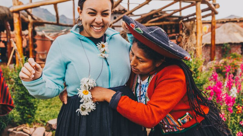 Two women in Peru wearing traditional costumes