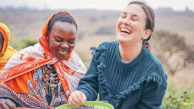 Two women laugh together in Nairobi
