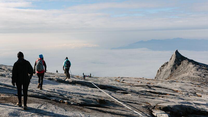 Hikers at the via ferrata on Mt Kinabalu