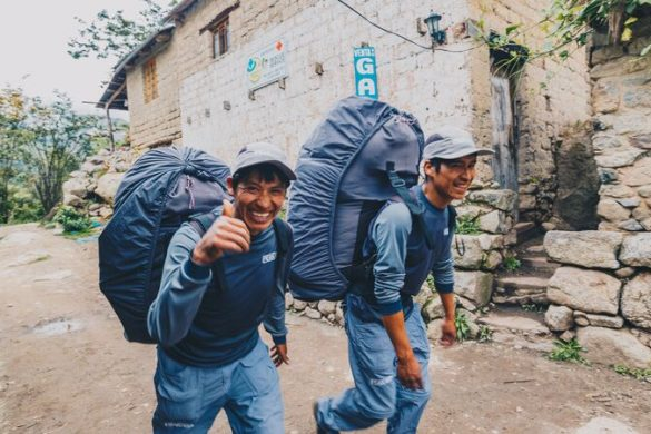Two smiling porters in Peru