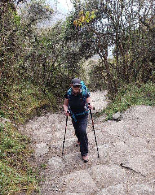 A hiker on the rocky steps of the Inca Trail
