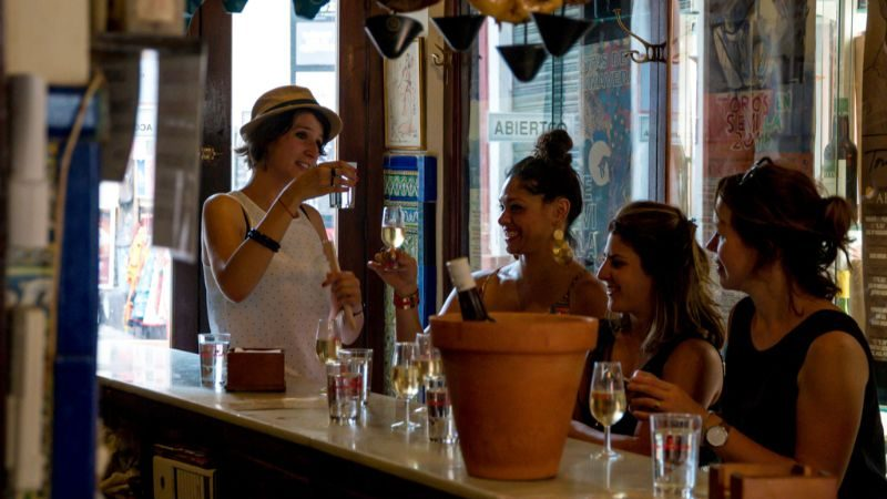 Four women at a bar in Spain