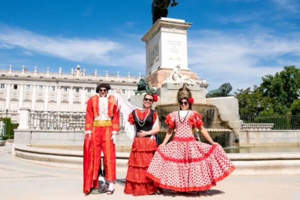 Three people wearing dressups outside a palace