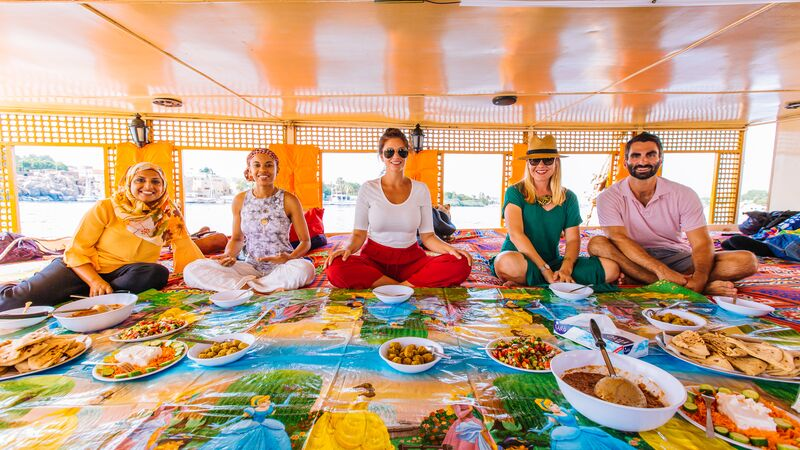 A group of travellers sitting on a boat in Egypt