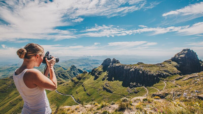 A woman taking a photo in South Africa