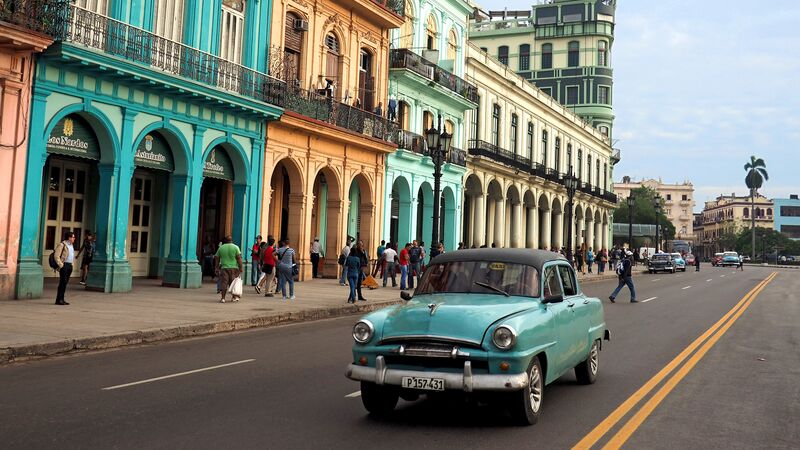 A car rolling down the streets of Havana - Cuba travel restrictions 2019