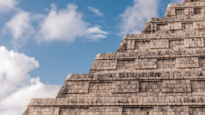 The steps on an ancient ruin in Mexico, with blue sky behind