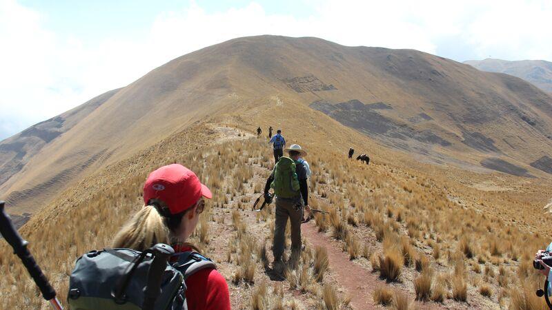 People hiking on a mountain in Peru