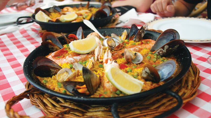 A pan filled with paella in Spain