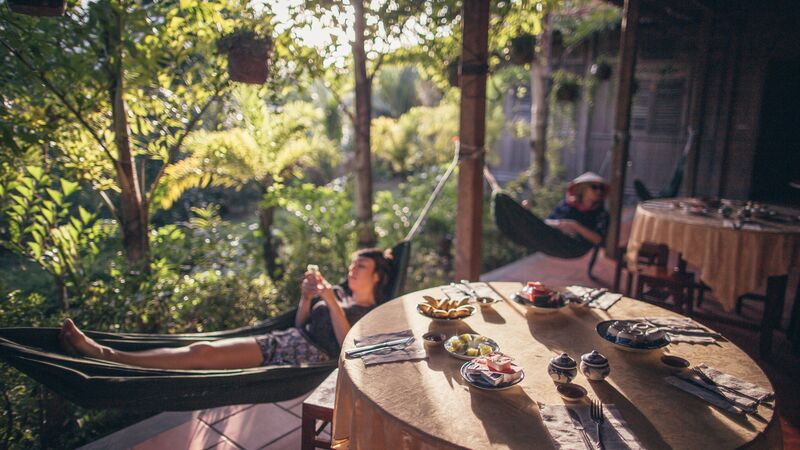 A traveller relaxing in a hammock