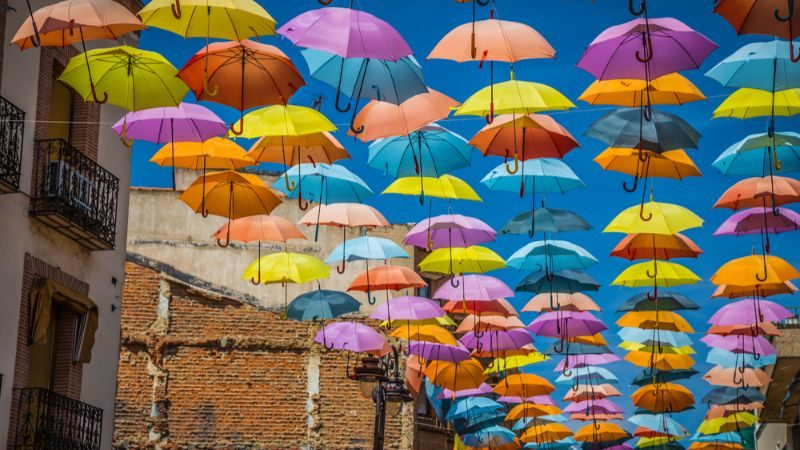 Colourful umbrellas hanging above the street