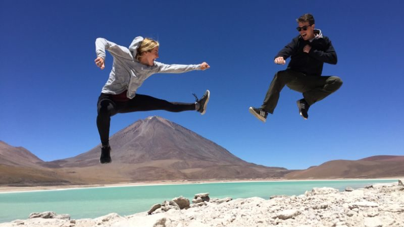 A couple jumping in the air in Bolivia
