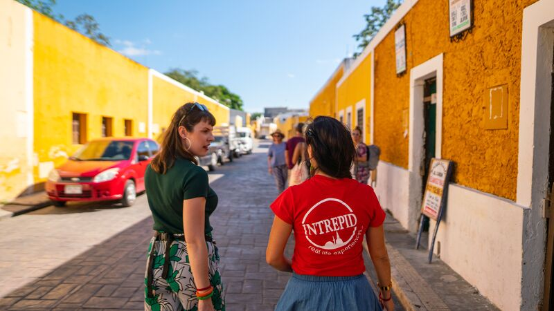 A group of travellers with a tour leader in Izamal, Mexico
