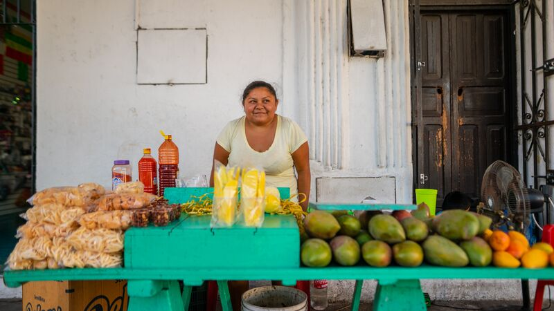 A woman selling mangoes in Izamal, Mexico