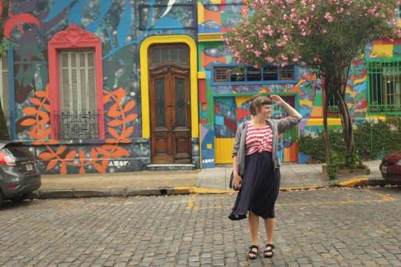 A young woman standing on a colourful street in Argentina