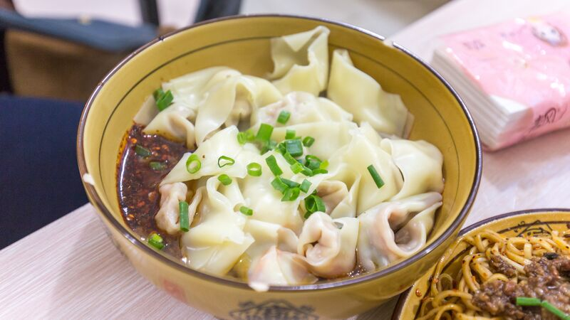 A bowl of dumplings and chilli